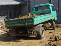 Извозване на отпадъци с камион